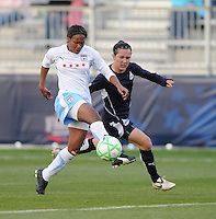 Chicago Red Stars defender Ifeoma Dieke (4) kicks the ball to defend the play agaisnt Washington Freedom forward Lisa De Vanna (17) Washington Freedom tied Chicago Red Stars 1-1  at The Maryland SoccerPlex, Saturday April 11, 2009.