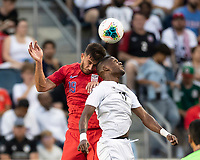 KANSAS CITY, KS - JUNE 26: Matt Miazga #19 and Armando Cooper #11 challenge for a header during a game between Panama and USMNT at Children's Mercy Park on June 26, 2019 in Kansas City, Kansas.