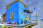Bright blue houseboat in Yellowknife Bay