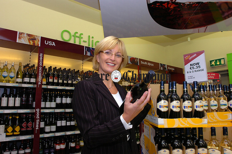 Kay Ryan in the Off Licence section of their new Centra store.
