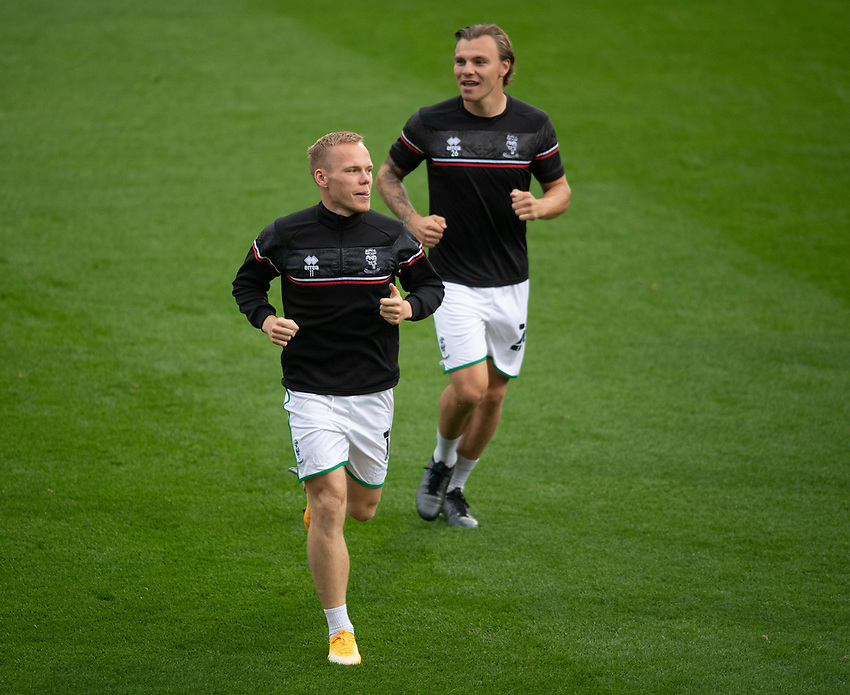 Lincoln City's Anthony Scully, left, and Harry Anderson during the pre-match warm-up<br /> <br /> Photographer Chris Vaughan/CameraSport<br /> <br /> Carabao Cup Second Round Northern Section - Bradford City v Lincoln City - Tuesday 15th September 2020 - Valley Parade - Bradford<br />  <br /> World Copyright © 2020 CameraSport. All rights reserved. 43 Linden Ave. Countesthorpe. Leicester. England. LE8 5PG - Tel: +44 (0) 116 277 4147 - admin@camerasport.com - www.camerasport.com