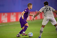 LAKE BUENA VISTA, FL - JULY 25: Chris Mueller #9 of Orlando City SC dribbles the ball during a game between Montreal Impact and Orlando City SC at ESPN Wide World of Sports on July 25, 2020 in Lake Buena Vista, Florida.