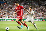 Robert Lewandowski (L) of FC Bayern Munich fights for the ball with Nacho Fernandez (R) of Real Madrid during their 2016-17 UEFA Champions League Quarter-finals second leg match between Real Madrid and FC Bayern Munich at the Estadio Santiago Bernabeu on 18 April 2017 in Madrid, Spain. Photo by Diego Gonzalez Souto / Power Sport Images
