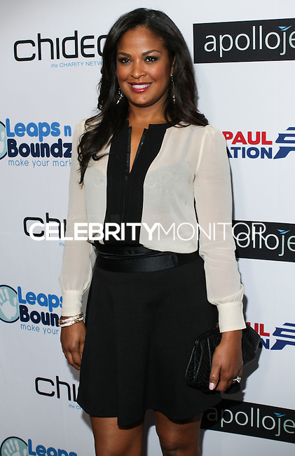 BEVERLY HILLS, CA, USA - OCTOBER 26: Laila Ali arrives at the CP3 Foundation Celebrity Server Dinner held at Mastro's Steakhouse on October 26, 2014 in Beverly Hills, California, United States. (Photo by Rudy Torres/Celebrity Monitor)