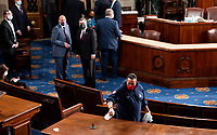 United States Capitol workers disinfect the House floor in the Capitol before members of the 117th Congress are sworn in on Sunday, January 3, 2021.<br /> Credit: Bill Clark / Pool via CNP /MediaPunch<br /> CAP/MPI/RS<br /> ©RS/MPI/Capital Pictures