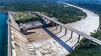 Austin, Texas. October 21, 2018: Water rushes through the 4 open flood gates at the LCRA Hydro Mansfield Dam. Mansfield Dam Park offers beautiful views of Lake Travis where families can picnic, swim in our secluded cove, fish, and play and includes the largest public boat ramp on Lake Travis with an extensive scuba diving park.