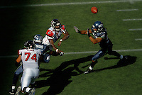 Sep 18, 2005; Seattle, WA, USA; Atlanta Falcons quarterback Michael Vick #7 throws a pass under pressure from the Seattle Seahawks in the third quarter at Qwest Field. Mandatory Credit: Photo By Mark J. Rebilas