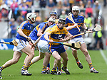 Tony Kelly of Clare in action against Dan Mc Cormack of Tipperary during their quarter final at Pairc Ui Chaoimh. Photograph by John Kelly.