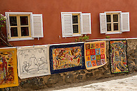 Paintings on Display in a Courtyard, Biannual Arts Festival, Goree Island, Senegal.