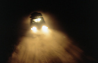 Angola. Cuando Cubango. A team from MSF (Médecins Sans Frontières) Switzerland drives back to Mavinga at night on a sandy roadtrack in an off road vehicle, a fourwheel drive Toyota Landcruiser . © 2002 Didier Ruef