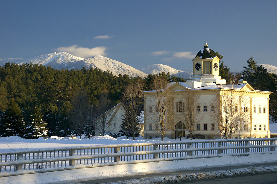 The Dow Academy building in Franconia New Hampshire, with Cannon Mtn. clad in winter white behind.