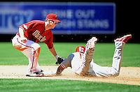 Apr. 27, 2011; Phoenix, AZ, USA; Arizona Diamondbacks shortstop Stephen Drew tags out Philadelphia Phillies base runner John Mayberry on a third inning steal attempt at Chase Field. Mandatory Credit: Mark J. Rebilas-
