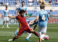 Calcio, Serie A: Lazio vs Roma. Roma, stadio Olimpico, 3 aprile 2016.<br /> Roma's Mohamed Salah, left, is challenged by Lazio's Patric during the Italian Serie A football match between Lazio and Roma at Rome's Olympic stadium, 3 April 2016.<br /> UPDATE IMAGES PRESS/Isabella Bonotto