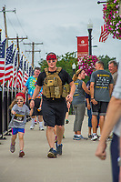 Active duty US Marine Justin McCulle4y and his four-year-old daughter, Lilyin, are just two of the runners in the 5K 9/11 Heroes Run in Westerville.