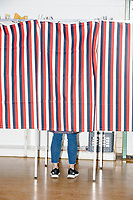 People vote in the New Hampshire Presidential Primary at Charlotte Ave Elementary School in Nashua, New Hampshire, on Tue., Feb. 11, 2020.