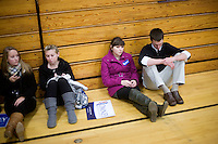People wait for Mitt Romney to arrive in the overflow area in a gymnasium at a Romney town hall campaign event at McKelvie Intermediate School in Bedford, New Hampshire, on Jan. 9, 2012.  Romney is seeking the 2012 Republican presidential nomination.