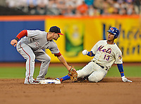 24 July 2012: Washington Nationals infielder Danny Espinosa gets Ronny Cedeno out at second during a game against the New York Mets at Citi Field in Flushing, NY. The Nationals defeated the Mets 5-2 to take the second game of their 3-game series. Mandatory Credit: Ed Wolfstein Photo