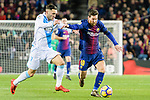 Jose Mato Sanmartin, Joselu, of RC Deportivo La Coruna (L) in action against Lionel Messi of FC Barcelona (R) during the La Liga 2017-18 match between FC Barcelona and Deportivo La Coruna at Camp Nou Stadium on 17 December 2017 in Barcelona, Spain. Photo by Vicens Gimenez / Power Sport Images