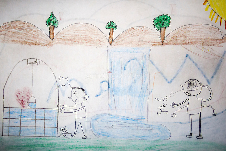 15/11/14. Alqosh, Iraq. A drawing by Wassam, he says the picture depicts two friends. The character on the right is named Johnson and is crying because his friend Wassam (left) is about to step on a mine as he collects water for flowers from a well.