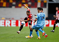 17th October 2020; Brentford Community Stadium, London, England; English Football League Championship Football, Brentford FC versus Coventry City; Henrik Dalsgaard of Brentford crosses the ball past Ryan Giles of Coventry City