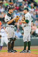 Catcher Devin Mesoraco #36 of the Lynchburg Hillcats has a talk with his starting pitcher Lance Janke during a game against the Winston-Salem Dash at  BB&T Ballpark May 22, 2010, in Winston-Salem, North Carolina.  Photo by Brian Westerholt / Four Seam Images
