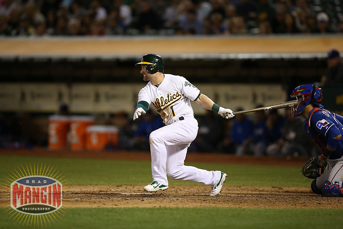 OAKLAND, CA - SEPTEMBER 17:  Nick Punto #1 of the Oakland Athletics bats against the Texas Rangers during the game at O.co Coliseum on Wednesday, September 17, 2014 in Oakland, California. Photo by Brad Mangin
