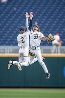 Michigan Wolverines outfielder Jordan Brewer (22) celebrates with teammate Jack Blomgren (2) following Game 11 of the NCAA College World Series against the Texas Tech Red Raiders on June 21, 2019 at TD Ameritrade Park in Omaha, Nebraska. Michigan defeated Texas Tech 15-3 and is headed to the CWS Finals. (Andrew Woolley/Four Seam Images)