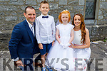 Saoirse Moynihan with her family at her first holy communion in the Church of the Immaculate Conception, Rathass on Saturday. <br /> Front: Jamie, Rian, Saoirse and Michelle Moynihan.