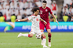 Mohamed Abdulrahman Alraqi of United Arab Emirates (L) fights for the ball with Karim Boudiaf of Qatar (R) during the AFC Asian Cup UAE 2019 Semi Finals match between Qatar (QAT) and United Arab Emirates (UAE) at Mohammed Bin Zaied Stadium  on 29 January 2019 in Abu Dhabi, United Arab Emirates. Photo by Marcio Rodrigo Machado / Power Sport Images
