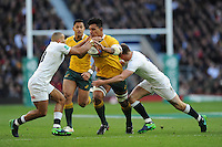 Lopeti Timani of Australia tackled by Jonathan Joseph and Owen Farrell of England during the Old Mutual Wealth Series match between England and Australia at Twickenham Stadium on Saturday 3rd December 2016 (Photo by Rob Munro)