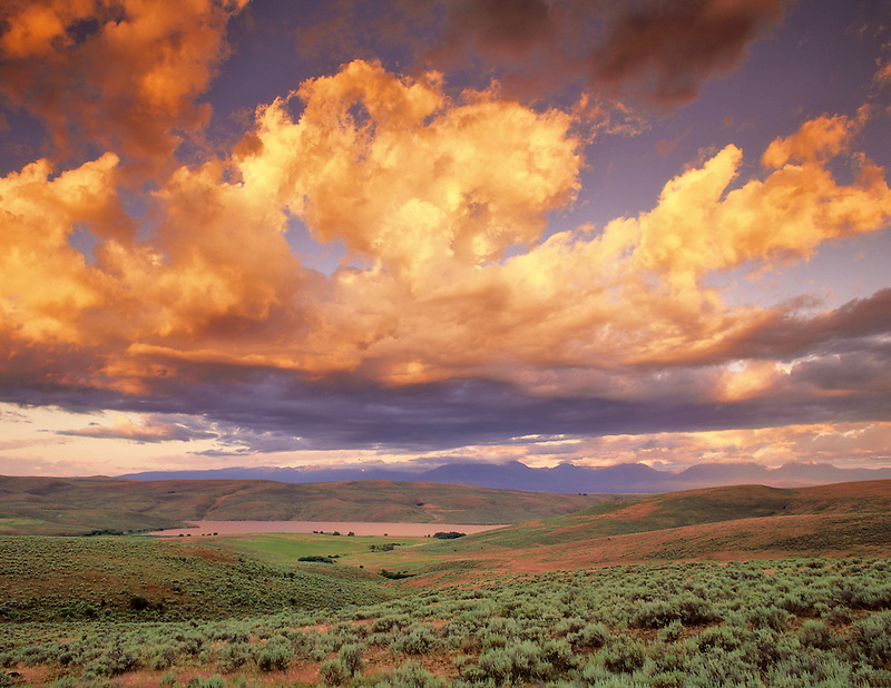 Sunrise over Thief Valley Reservoir with Blue Mountains in distance, Oregon
