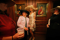 Stylish hats are a long-standing tradition at the Kentucky Derby.  <br /> A long-standing tradition at the Kentucky Derby is for women to wear stylish hats. Competition for the best dressed is nearly as fierce as the race outside, says a Churchill Downs track official. Women parade in front of jockey portraits in Turf Club.