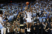 CHAPEL HILL, NC - MARCH 03: Christian Keeling #55 of the University of North Carolina shoots over Sharone Wright Jr. #2 of Wake Forest University during a game between Wake Forest and North Carolina at Dean E. Smith Center on March 03, 2020 in Chapel Hill, North Carolina.