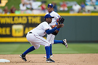 Round Rock Express shortstop Jurickson Profar #10 awaits the throw from the catcher during a New Orleans Zephyrs steal attempt in the Pacific Coast League baseball game on April 21, 2013 at the Dell Diamond in Round Rock, Texas. Round Rock defeated New Orleans 7-1. (Andrew Woolley/Four Seam Images).
