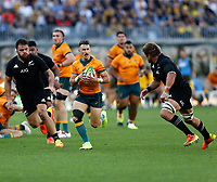 5th September 2021; Optus Stadium, Perth, Australia: Bledisloe Cup international rugby, Australia versus New Zealand; Nic White of the Australian Wallabies looks for a team mate to pass off to