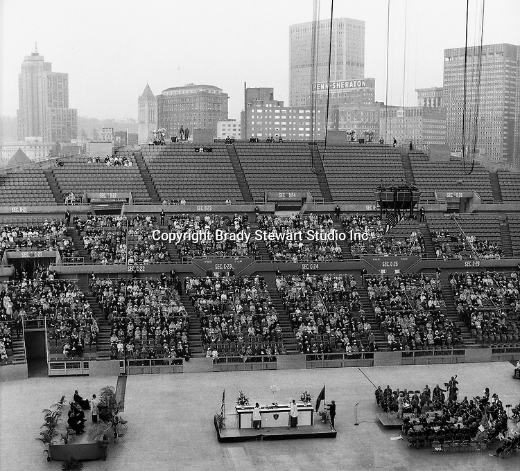Pittsburgh PA:  On location photography for the Council of Churches. Easter Sunrise Service at the Civic Arena with the roof open. It was amazing to be 10 years old and watch the roof slowly open at the Civic Area. The Council of Churches was a merger of three local groups; the Allegheny County Sabbath School Association, the Pittsburgh Council of Churches, and the Council of Weekday Religious Education.  The council's objection was to better relate and understand other religions including the local Jewish, African American, Catholic and Christian churches in the downtown Pittsburgh area.