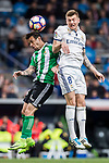 Toni Kroos of Real Madrid fights for the ball with Ruben Castro of Real Betis during their La Liga match between Real Madrid and Real Betis at the Santiago Bernabeu Stadium on 12 March 2017 in Madrid, Spain. Photo by Diego Gonzalez Souto / Power Sport Images