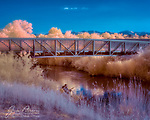 Beneath The Bridge (Infrared).  It was an idyllic Utah summer afternoon along the Jordan River south of Salt Lake City when my infrared camera spotted these fishermen.<br /> <br /> Tech info: Nikon D3200 camera (modified for infrared with 590nm filter), Nikon 18-140mm lens at 35mm, 1/400 sec. at f11, ISO 400<br /> <br /> Image ©2021 James D. Peterson