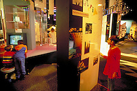 Mixed ethnic girl and boys aged 10 to 13 interact with science exhibits at the Mandell Futures Center of the Franklin Institute. children. Philadelphia Pennsylvania United States.