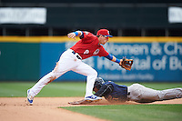 Buffalo Bisons second baseman Andy Burns (8) stretches for a throw as Cesar Puello (21) slides into second during a game against the Scranton/Wilkes-Barre RailRiders on July 2, 2016 at Coca-Cola Field in Buffalo, New York.  Scranton defeated Buffalo 5-1.  (Mike Janes/Four Seam Images)