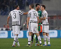 Calcio, Serie A: Lazio vs Juventus. Roma, stadio Olimpico, 4 dicembre 2015.<br /> Juventus' players, from left, Giorgio Chiellini, Leonardo Bonucci, Gianluigi Buffon and Stephan Lichsteiner celebrate at the end of the Italian Serie A football match between Lazio and Juventus at Rome's Olympic stadium, 4 December 2015. Juventus won 2-0.<br /> UPDATE IMAGES PRESS/Isabella Bonotto