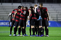 CARY, NC - DECEMBER 13: Stanford University's Starting XI huddle on the field during a game between Stanford and Georgetown at Sahlen's Stadium at WakeMed Soccer Park on December 13, 2019 in Cary, North Carolina.