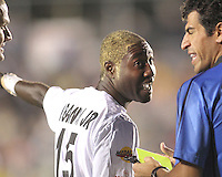 Sandy Gbandi #15 of the Puerto Rica Islanders argues with referee Fotis Bazakos  during the second leg of the USSF-D2 championship match against theCarolina Railhawks at WakeMed Soccer Park, in Cary, North Carolina on October 30 2010. The game ended 1-1, Puerto Rico won 3-1 on overall goals.