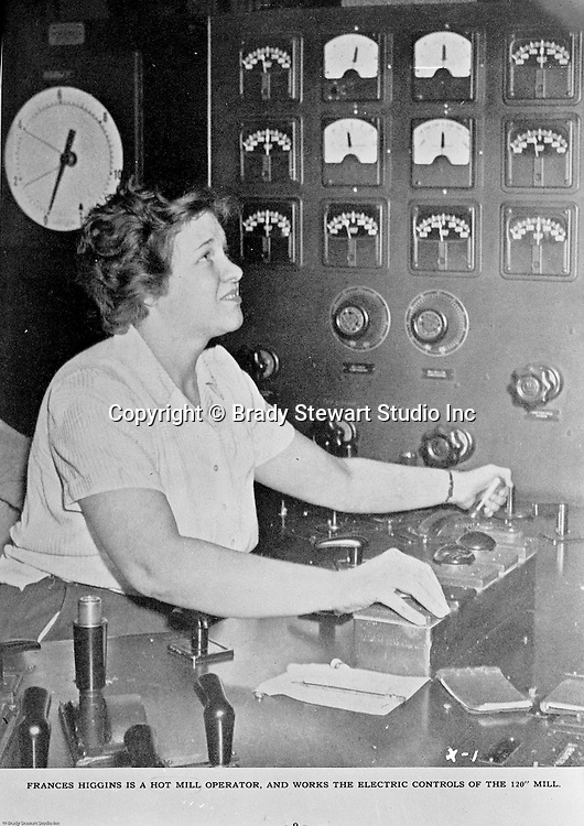 """Spokane Washington and McCook Illinois: View of Swindell-Dressler brochure highlighting the Electric Furnaces designed, constructed, and installed in two Alcoa plants during World War II. The caption reads: Frances Higgins is a Hot Mill Operator and works the controls on the 120"""" mill."""