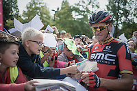Olympic Champion & overall kids hero Greg Van Avermaet (BEL/BMC) signing autographs to the many school kids that showed up at the start of the stage in Aalter (Belgium).<br /> <br /> 12th Eneco Tour 2016 (UCI World Tour)<br /> stage 4: Aalter - St-Pieters-Leeuw (202km)