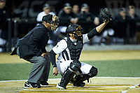 Wake Forest Demon Deacons catcher Christian Long (19) reaches for a pitch as home plate umpire Gregory Street looks on during the game against the Sacred Heart Pioneers at David F. Couch Ballpark on February 15, 2019 in  Winston-Salem, North Carolina.  The Demon Deacons defeated the Pioneers 14-1.  (Brian Westerholt/Four Seam Images)