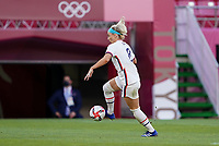 KASHIMA, JAPAN - JULY 27: Julie Ertz #8 of the United States turns and moves with the ball during a game between Australia and USWNT at Ibaraki Kashima Stadium on July 27, 2021 in Kashima, Japan.