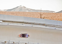 8 January 2016: Jane Channell, competing for Canada, slides through Curve 14, with Whiteface Mountain as a backdrop, on her first run of the BMW IBSF World Cup Skeleton race at the Olympic Sports Track in Lake Placid, New York, USA. Mandatory Credit: Ed Wolfstein Photo *** RAW (NEF) Image File Available ***