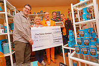 Pictured: Captain Beany presents a cheque to the Daisy Garland Charity.  Sunday 27 January 2019<br /> Re: 10 year anniversary of the Baked Bean Museum of Excellence, owned by Captain Beany (real name Barry Kirk) in a Council flat in Port Talbot, south Wales, UK.