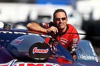 Nov 8, 2013; Pomona, CA, USA; NHRA pro stock driver Greg Anderson during qualifying for the Auto Club Finals at Auto Club Raceway at Pomona. Mandatory Credit: Mark J. Rebilas-